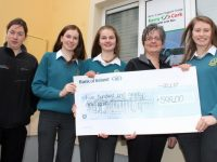 Breda Dyland, Manager of Kerry Cancer Support Group (second right) accepts a cheque from Mercy Mounthawk Students, Jenny Fox (second left), Amy O'Mahony and Katie Nagle. Also included is Administrator at KCSG, Trish Kelly. Photo by Dermot Crean