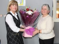 Gemma O'Brien makes a presentation to Christine Coffey at her farewell party at KDYS Denny Street on Tuesday. Photo by Lisa O'Mahony
