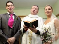 The 'groom' David Culloty and 'bride' Niamh Moriarty with the 'priest' Jimmy Adams at the Na Gaeil GAA Club 'One Wedding And A Funeral' event at their clubhouse on Saturday night. Photo by Dermot Crean