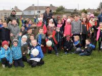 Cormac Coffey, David Moran and Barry John Keane with youngsters at the launch of the Kerins O'Rahillys Juvenile Academy on Sunday afternoon. Photo by Dermot Crean