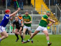 Mikey Boyle shoots during the match on Sunday. Photo by Dermot Crean