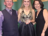 Rachel Bowler with Parents, Pat and Marian Bowler, collecting  her Award at the Emerald Crystal AAI Sports Stars Tullamore on Saturday.