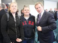 An Taoiseach Enda Kenny with students Kelly O'Regan and Kate O'Riordan at IT Tralee on Monday. Photo by Lisa O'Mahony.