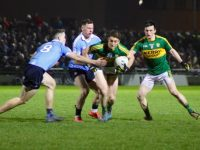 Stephen O'Brien aims to break free from Philly McMahon and Brian Fenton while Paul Murphy looks on. Photo by Dermot Crean