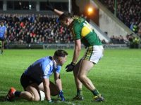 Paul Geaney stands over Philly McMahon in the closing stages of the game. Photo by Dermot Crean