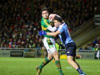 David Moran and Shane McCarthy clash. Photo by Dermot Crean