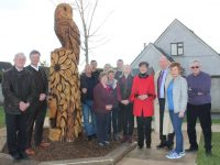 Pat McCarthy, Graham Spring, Sam Locke, Aidan O'Mahony, Pa Daly, Anne Walsh, Anne McCarthy, Louise Farrell, Norma Foley, Jim Finucane and Jennifer Mackey at the unveiling of of the Wood Sculpture at Manor Park on Monday. Photo by Lisa O'Mahony.