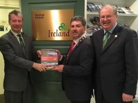 Mayor Michael O'Shea presents the new Kerry Tourism Strategy to Billy Condon, Vice Prseident, Tourism Ireland North America in New York. On right is the County Tourism Officer John