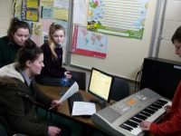 Students at Coláiste Gleann Lí preparing for a music performance as part of Kerry Music Education Partnership's pilot Take Note Vocal and Instrumental Tuition Initiative.