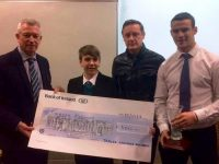 Tiernan Brosnan with the cheque of €500 he won in the 'Our Big Idea' competition. Also included is Kieran Rutledge of Tralee Chamber Alliance, teacher Shane Kissane and Bank Of Ireland's Shane Enright. Photo: Tralee Chamber Alliance Facebook