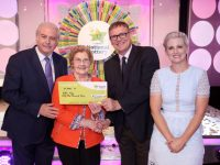 Nellie Foley, from Killarney, Co. Kerry has won €53,000 including a holiday on last Saturdays (22nd April 2017) National Lottery Winning Streak game show on RTE.  Pictured here at the presentation of the winning cheques were from left to right: Mr.  XXX  National Lottery ticket selling agent, Ms. Feng YU Chen, the News Stop, Ballally Shopping Centre, Dublin 16, Marty Whelan, Winning Streak game show co-host; Nellie Foley, the winning recipient; Michael Hayes, Head of Marketing, The National Lottery and Sinead Kennedy, Winning Streak game show co-host. The winning ticket was bought from Topaz garage. Pic: Mac Innes Photography.