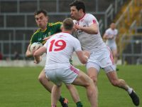Jack Barry challenged by Tyrone players in last year's league encounter.