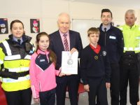 Sergeant Eileen O'Sullivan, Jimmy Deenihan, Aidan O'Mahony and Seamus Moriarty presenting members of the Student Council Kaley Killeen and Sean Locke with Certificates for the 'Walk a Marathon in a Month' Challenge. Photo by Lisa O'Mahony.