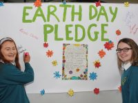 Rebecca Dennehy and Sadhbh Norris signing the 'Earth Day Pledge' at Mercy Mounthawk on Friday morning. Photo by Dermot Crean