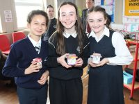Clemence Igleglesias, Ciara Dowling and Molly Sheehy at their Junior Entrepreneur Programme showcase at Spa National School on Monday. Photo by Lisa O'Mahony.