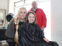 Rachel O'Connor, with parents Jacinta and Kevin, with her shorn locks. Photo by Dermot Crean