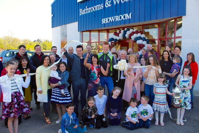 Photos world of tiles opens at the mile height traleetoday kerry gaa star johnny buckley helps fiona higgins cut the tape cheered on by well wishers at the opening of world of tiles on saturday tyukafo
