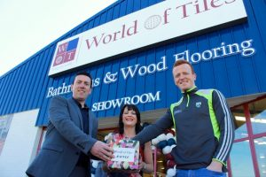 Photos world of tiles opens at the mile height traleetoday johnny buckley drawing the winner of the raffle at the opening of world of tiles on saturday with donal and fiona higgins photo by dermot crean tyukafo
