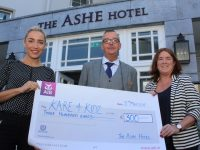 Sales and Marketing Executive and Deputy General Manager of the Ashe Hotel, Ivan Ashe, present Grace O'Donnell of Kare4Kidz with the proceeds of a recent Easter party held at the hotel. Photo by Dermot Crean
