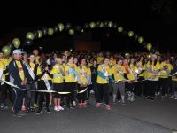 Kerry Rose Danielle O'Sullivan cuts the tape to start the Darkness Into Light Tralee event on Saturday morning. Photo by Dermot Crean
