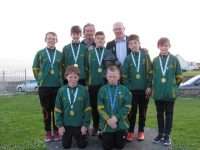 From left to right.   Dara Donnelly, Denis Lynch,    Back Row . Dara Kearney, Adam Dineen, Charlie Fitzgerald, David O'Sullivan, Oisín O'Regan, with their teacher and coach Terence Dineen and John Brassil T.D.