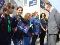 The Duke of Kent meets members of the Fenit 8th Kerry Scouts during his visit to Fenit RNLI on Tuesday afternoon. Photo by Dermot Crean
