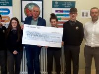 Mister Dónal Ó Ruanaidh and Gaelcholáiste Chiarraí students presenting the cheque to Jimmy Mulligan from Jigsaw Kerry.