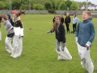 Sack racing at the Gaelcholáiste Chiarraí Sports Day at Na Gaeil GAA grounds on Friday. Photo by Dermot Crean