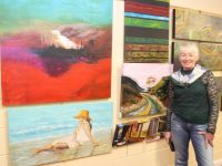 Catriona O'Sullivan and her work at the art exhibition at Coláiste Gleann Lí on Thursday evening. Photo by Dermot Crean