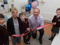 Calum O'Leary (centre) prepares to cut the tape to open the new sensory room at Holy Family NS on Tuesday. Included are Franek Siekaniec, Ann Marie Allen SNA, Principal Ed O'Brien and Kyra Prendergast. Photo by Dermot Crean
