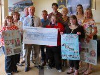 Chairman of Kerins O'Rahillys, Haulie Kerins, presents a cheque for €500 to Inspired members at a recent night to