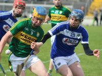 Paudie O'Connor comes under pressure from Stephen Bergin.  Photo by Dermot Crean
