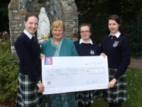 Presentation students presenting Sr Bríd, accepting on behalf of Cuan Mhuire, with a cheque for €1,000, from students Katie Ahern, Aine O'Sullivan and Aoife O'Sullivan. Photo by Dermot Crean
