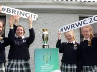 Students with the Women's Rugby World Cup at Presentation Secondary School on Tuesday. Photo by Dermot Crean