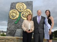 Eibhlín and Dick Henggeler and Rose of Tralee Maggie McEldowney at the Rose of Tralee monument on the Ballymullen roundabout on Wednesday. Photo by Dermot Crean
