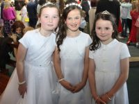 Nicole Hartmann, Jocelyn Cushen and Kara Kirby who made their First Holy Communion at Our Lady and St Brendan's Church on Saturday morning. Photo by Dermot Crean