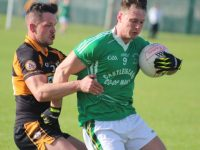 Shane Carroll tackles James Walsh of St Kieran's. Photo by Dermot Crean