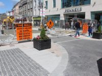 The entrance to The Mall from Denny Street with potted plants brightening up what is still technically a building site. Photo by Dermot Crean