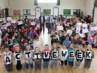 Aidan O'Mahony and Patrick Sayers with students of Presentation Primary School, celebrating the beginning of Sports Activity Week. Photo by Lisa O'Mahony.