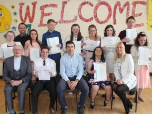 At the St Ita's and St Joseph's Graduation day were, front from left; Fr Patsy Lynch, Desmond Dreher, Aidan O'Mahony, Siobhan Looney, Principal Grace Sheehan. Back from left; Ann Marie Ladden, SNA Adrian Sheehan, Nicole O'Sullivan, Cian Begley, Cliona Palmer, Jessica Doona, Sharon Sheehan and Luadh Broadberry and Rachel O'Connor. Photo by Dermot Crean