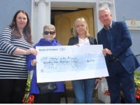 Celene Moloney, Anne O'Reilly and Kieran Ruttledge of Tralee Chamber Alliance presenting a cheque to Dolly Lawlor accepting on behalf St Mary Of The Angels, Beaufort, the proceeds of two fundraising events during the Tír na nÓ festival. Photo by Dermot Crean