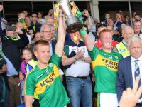 Fionn Fitzgerald and Johnny Buckley lift the cup. Photo by Will Nolan