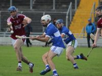 Jason Leahy tries to block David Griffin. Photo by Dermot Crean