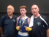 Patrick McCarthy (centre) with Noel and Tommy Kelliher of Tralee Boxing Club at the National Stadium on Friday.