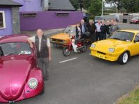 Launching the Kerry Vintage Club's upcoming charity run were Paul Horan and Tom Glover. At back; Joan Glover, Timmy Connor, Peter O'Connor, John Reidy, George Glover, Garrett Foley, Brian Glover and Gary Horan. Photo by Dermot Crean