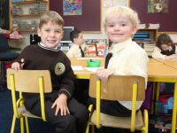 Harry Rooney and Max Fitzgibbon on their first day at Gaelscoil Mhic Easmainn on Wednesday morning. Photo by Dermot Crean