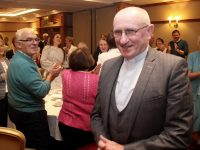 Fr Patsy Lynch gets a standing ovation as he enters the room at his farewell get-together at The Meadowlands Hotel on Thursday night. Photo by Dermot Crean
