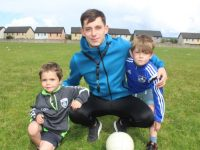 Kerry star Jack Savage with cousins Elliot and Taylor Savage  at Kerins O'Rahillys GAA Club summer camp on Friday. Photo by Dermot Crean