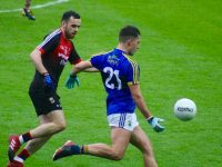 Jack Savage about to lay off a pass in yesterday's game. Photo by Dermot Crean