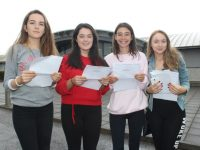Mercy Mounthawk students Marisa O'Connell, Ciara McCarthy, Sinead Deasy and Michaela Hennessy receiving their results on Wednesday morning. Photo by Dermot Crean